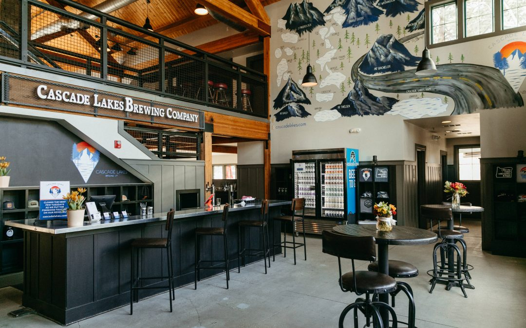 The entry to Cascade Lakes Brewing Company in Bend, Oregon features a painting of the region's rivers, lakes and mountains.