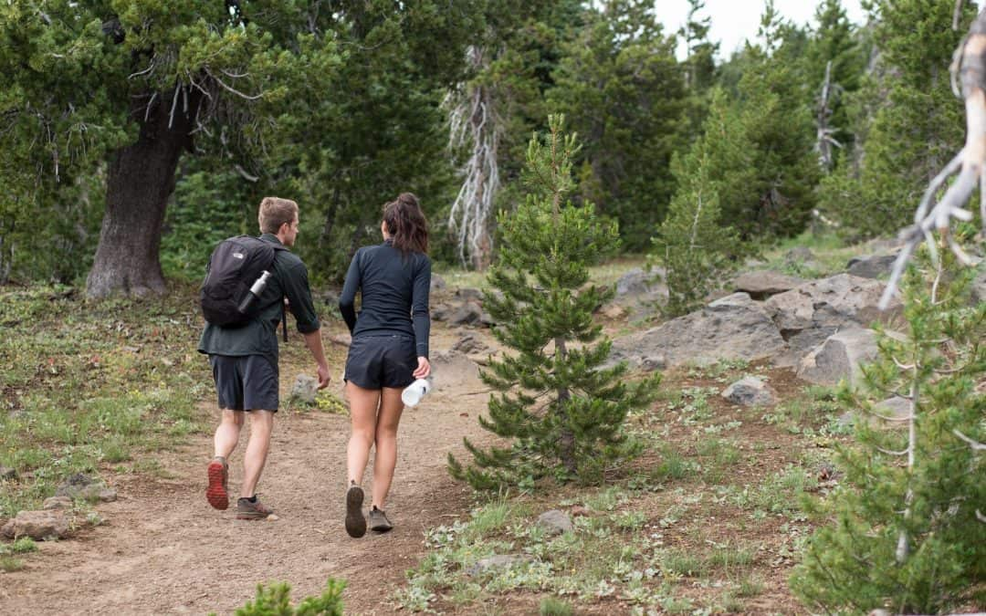 A pair hikes near Mt Bachelor in Central Oregon