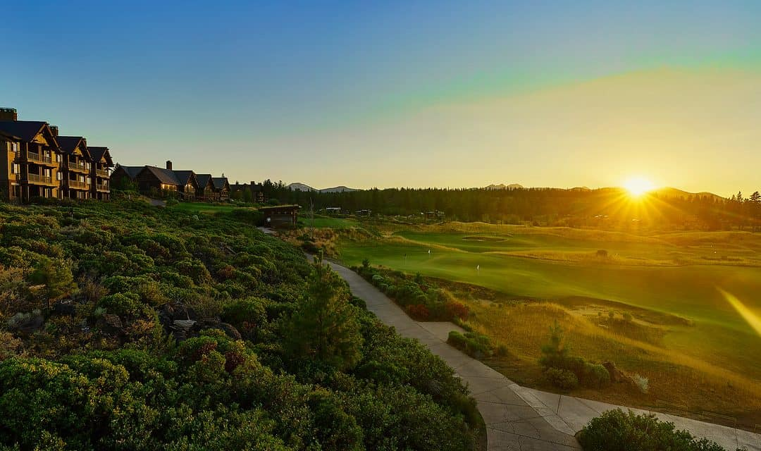 A sunset over Tetherow Resort and golf course in Central Oregon