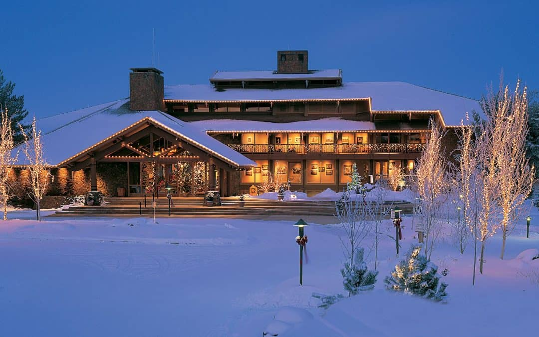 The Sunriver Resort in Sunriver, Oregon, is lit up by holiday lights and covered in snow.