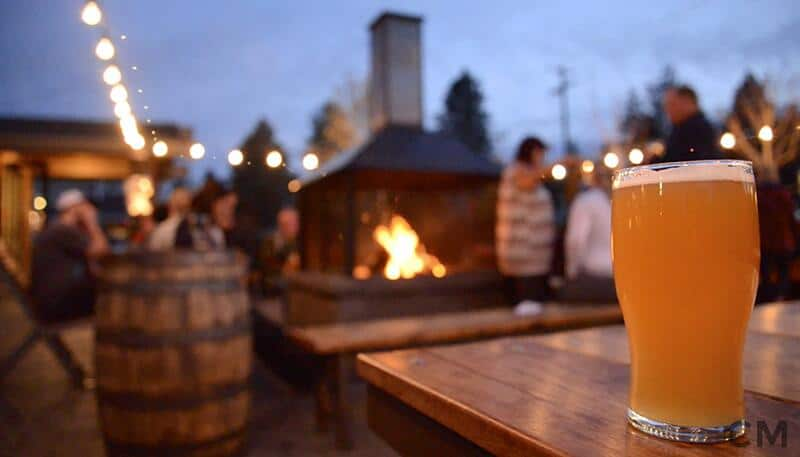 A glass of beer sits on a table on the patio of 10 Barrel Brewing Co. in Bend, Oregon.
