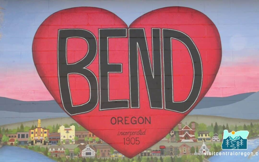 A mural on the side of Newport Avenue Market shows downtown Bend and a heart that says Bend, Oregon, incorporated 1905.