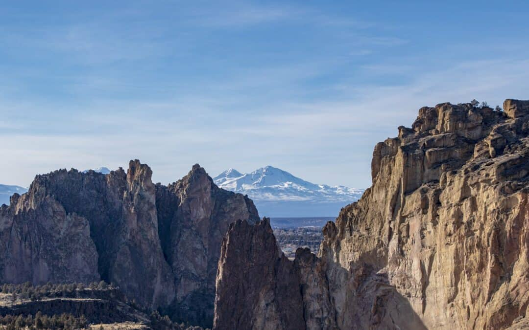 View of Smith Rock State Park with sno-capped mountain in distance